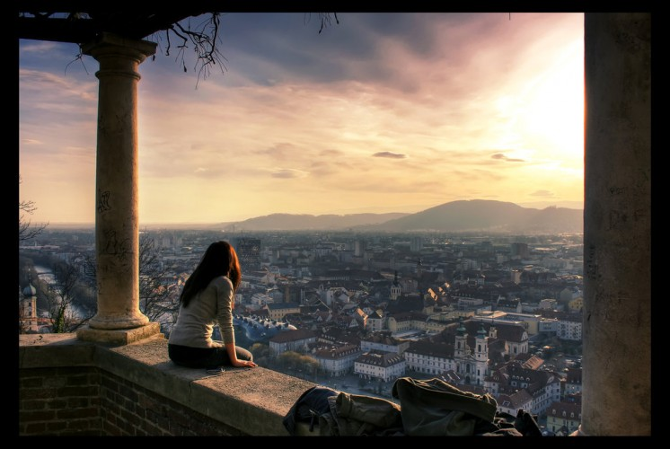 red-haired woman overlooking city