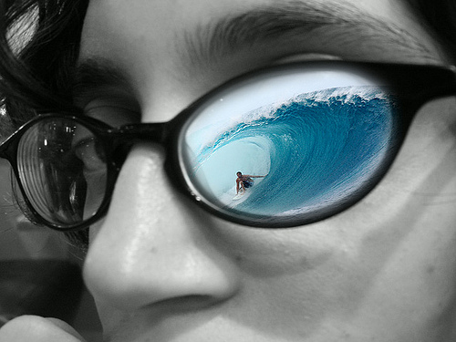 woman with ocean view in her glasses