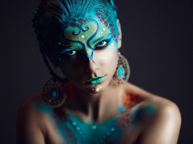 woman with turquoise face art