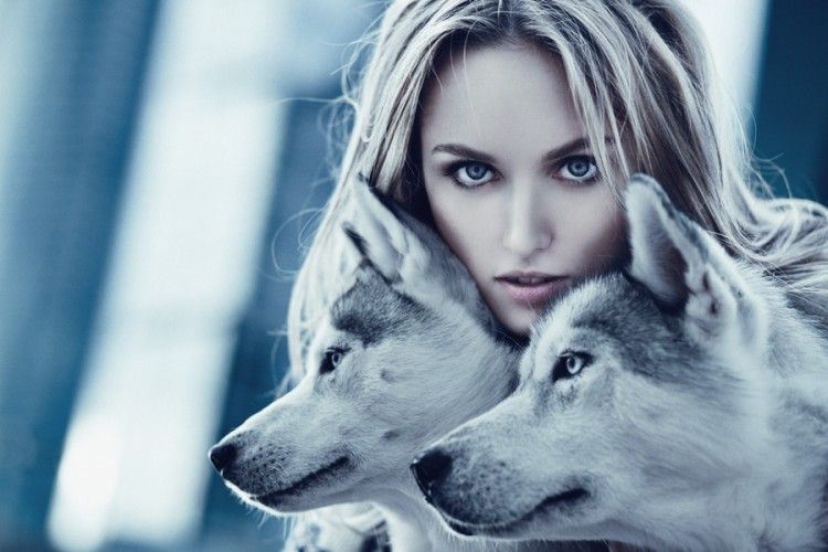 women with two wolves